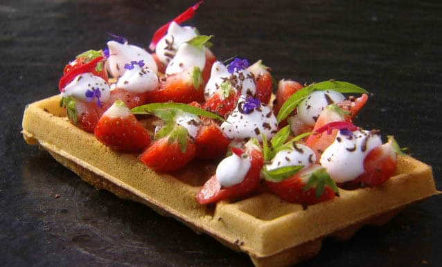 Brussels waffle with strawberries and whip cream.